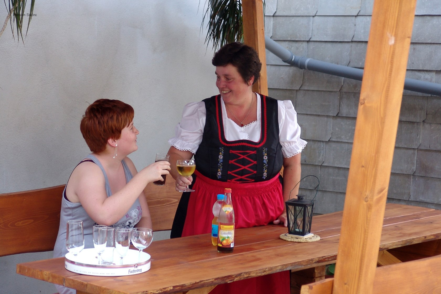 Mrs. Hampe serving a guest a drink